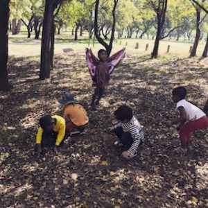 children playing in leaves, benefits of nature for children